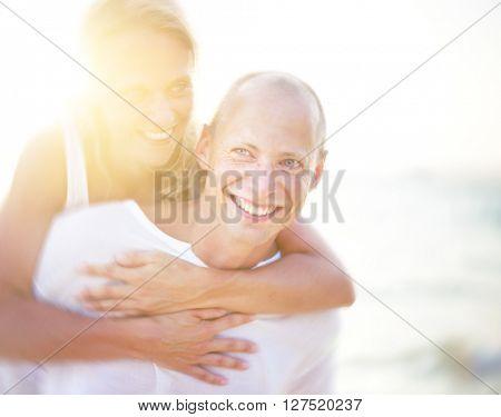 Couple Carrying Beach Concept