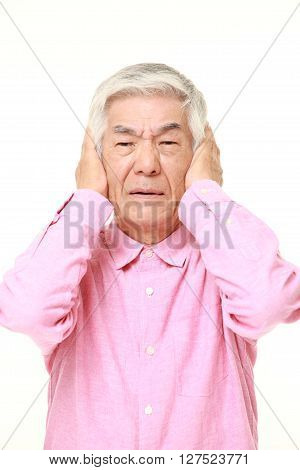 senior Japanese man suffers from noise on white background