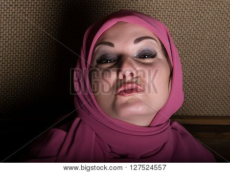 close-up beautiful mysterious eyes eastern woman wearing a hijab.