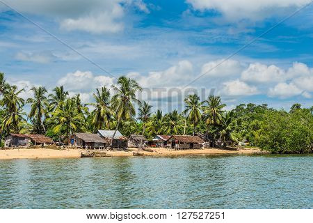 Ambatozavavy Nosy Be Madagascar - December 19 2015: Traditional fishing village Ambatozavavy with wooden dugout rowing vessels on the island of Nosy Be Madagascar.