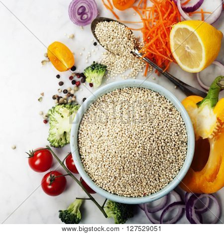 Bowl of healthy white quinoa seeds and fresh organic vegetables - Healthy Eating, Diet, Vegetarian or Cooking concept