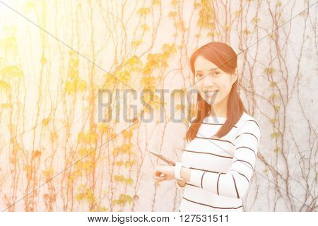 Woman using mobile phone and smart watch