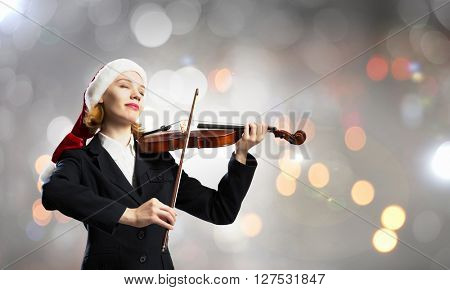 Santa woman play violin