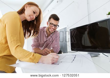 business, startup, architecture and people concept - happy creative architect team or students with blueprint and computer working at office