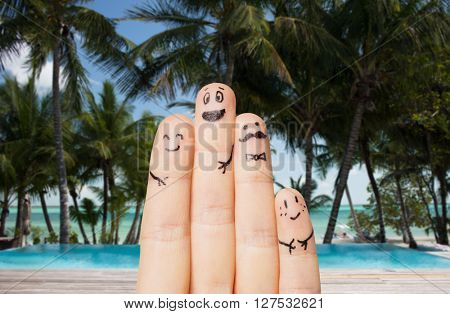 travel, tourism, summer vacation, people and body parts concept - close up of fingers family with smiley faces over exotic tropical beach with palm trees background