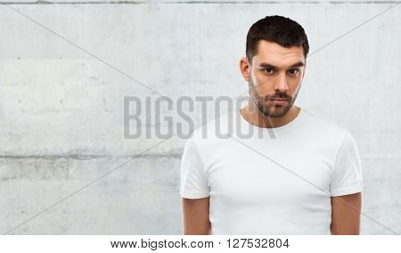 people concept - young man portrait over gray wall background