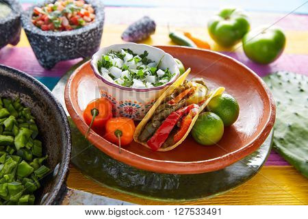 Nopal taco mexican food with chili pepper and ingredients on colorful table