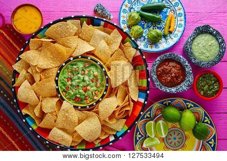 Nachos with guacamole tortilla chips in sombrero plate and sauces