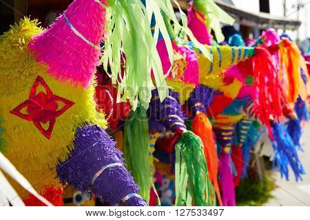Mexican party pinatas decorated with fringed tissue colorful paper