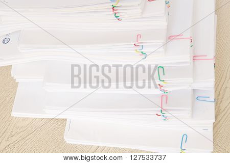 Colorful Paper Clip With Stack Of Overload Document