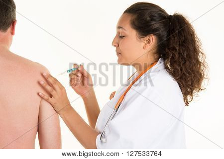 Young medical worker gives an injection to a man isolated