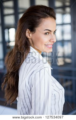 Close-up of beautiful young businesswoman in office