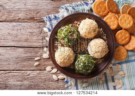 Goat Cheese Balls With Crackers, Herbs And Pumpkin Seeds. Horizontal View From Above
