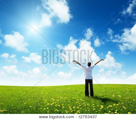 field of grass and happy young man