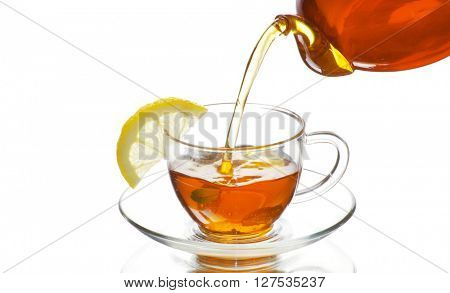 Glass cup of black tea. Isolated on white background