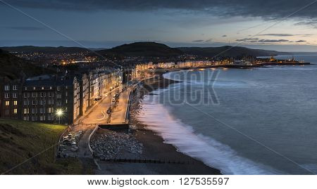 Aberystwyth Promenade, on the west coast of Wales, at dusk, with a slow shutter speed