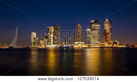 Rotterdam, The Netherlands - February 29, 2016: Wilhelminapier in Rotterdam seen from the Westerkade with Nieuwe Maas and Erasmus Bridge.