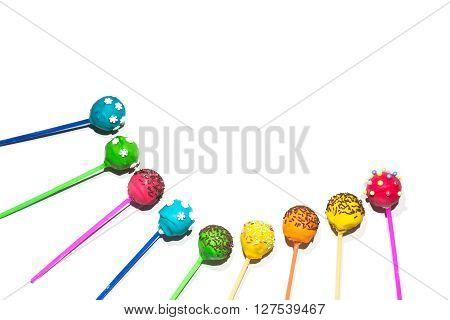 Colored cakepops on a white background. Holiday sweets