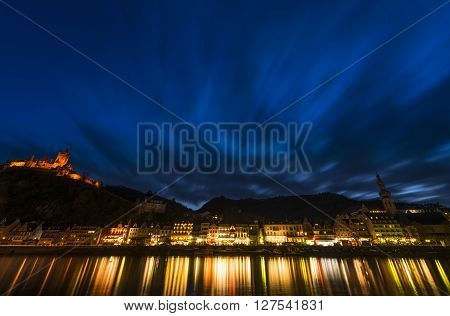 Cochem, Germany - March 28, 2016: View on Cochem at the Mossele in Germany at night with lights and a great castle Reichsburg.