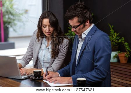 Business people working with laptop and coffee at the coffee shop