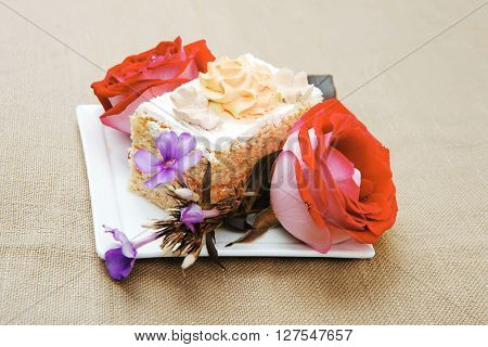 sweet food: tender cheese cream cake served on white dish with roses