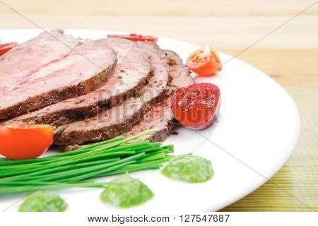 grilled barbecue on white dish with capers
