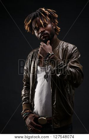 African-american guy in brown leather jacket looking at camera