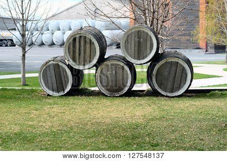 Wooden barrels outdoor near wine cellar