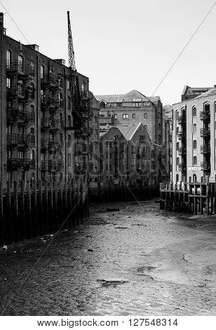 a black and white photo of the Java Wharf in the Shad Thames area of London