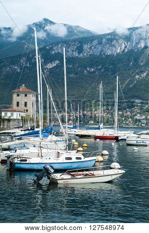 Bellagio, Italy - September 2nd 2015: photo of boats floating on Lake Como near the town of Bellagio Lombardy Italy.