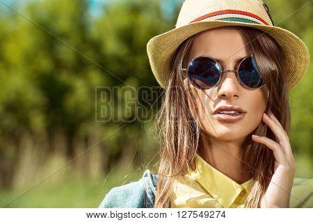 Beautiful smiling girl wearing casual summer clothes enjoys sunny day. Beauty, fashion shot.