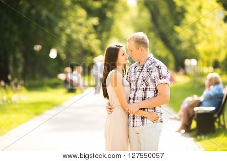 Teen couple lovely hugging on nature and have fun in park. Happy couple.