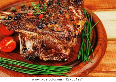 grilled ribs on wooden table with vegetables