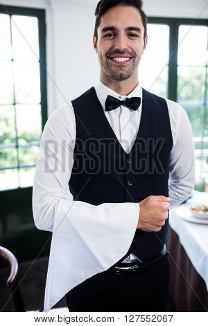 Portrait of waiter smiling at camera in a restaurant