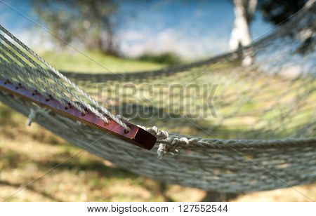 closeup of a white hammock photographed at Piani d'Erna (part of the Alps) near Lake Como in Italy