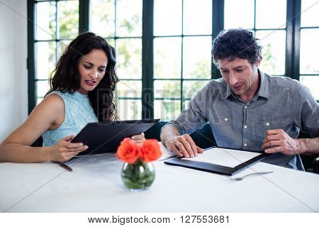 Couple discussing menu in a restaurant