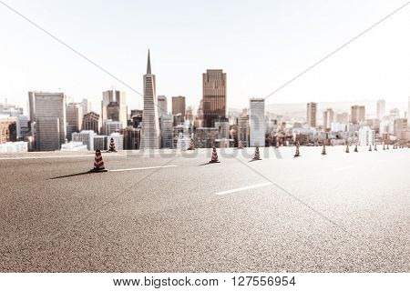 asphalt road with cityscape and skyline of san francisco