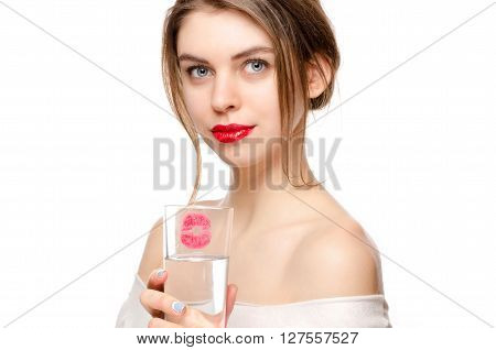 Beautiful Girl Holds a Glass of Pure Water