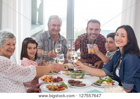 Family sitting at dining table having meal