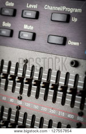 Color image of many buttons in a sound recording studio.