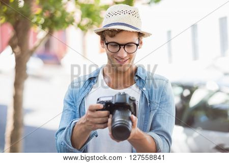 Happy young man looking in to camera