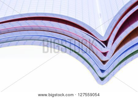 Stack of opened exercise books isolated on white background
