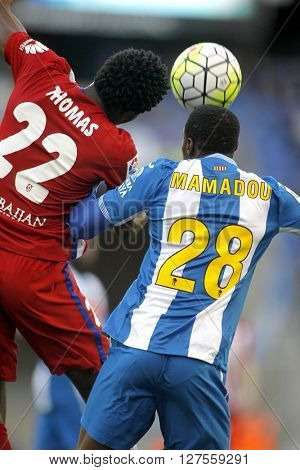 BARCELONA - APRIL, 9: Thomas Partey(L) of Atletico Madrid and Mamadou Sylla(R) of RCD Espanyol vie during a Spanish League match at the Power8 stadium on April 9, 2016 in Barcelona, Spain