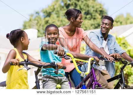 Happy family doing bicycle at park