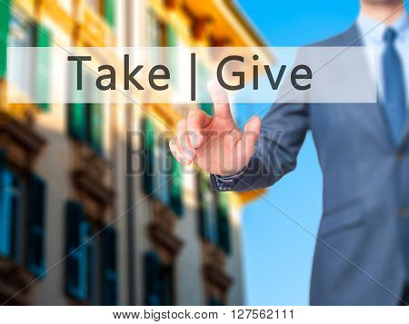 Give  Take - Businessman Hand Pressing Button On Touch Screen Interface.