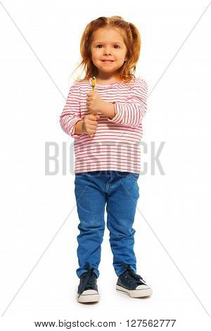 Whole-length portrait of funny little girl holding yellow toothbrush isolated on white