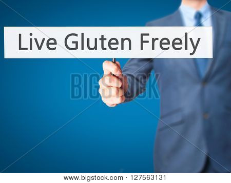 Live Gluten Freely - Businessman Hand Holding Sign