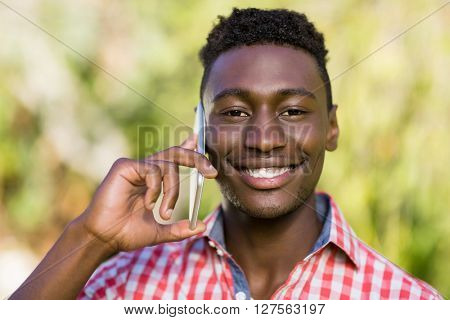 Happy man using his smartphone at the park