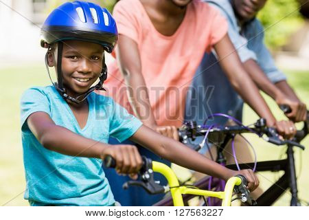 Young man doing bicycle at park