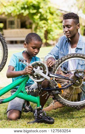 Happy family repairing a bike